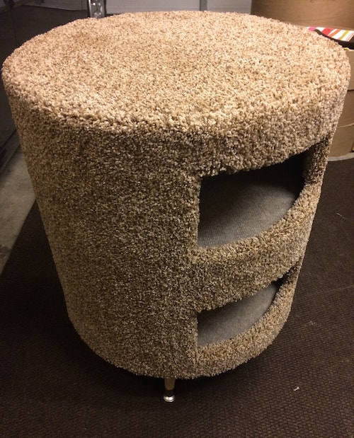 top view of a round carpeted two-story cat condo.