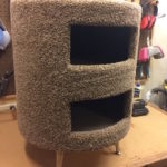 a round carpeted two-story cat condo.